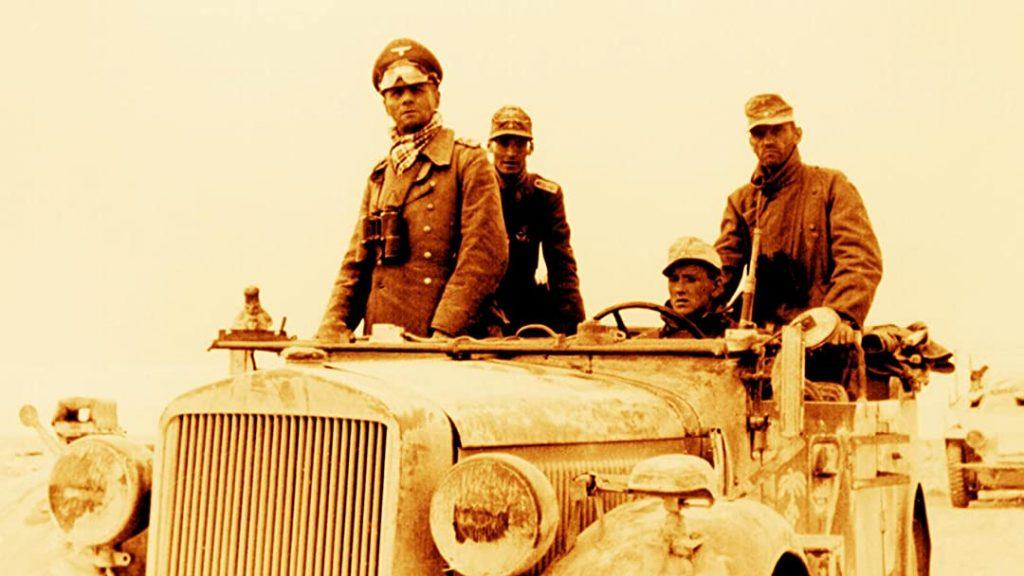 Afrika Korp wearing greatcoat over the Desert Fox Commanders jacket