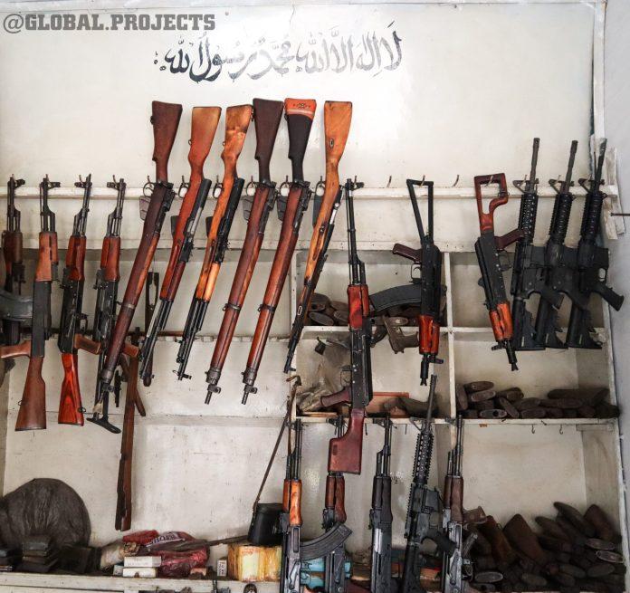 Taliban fighters guns
