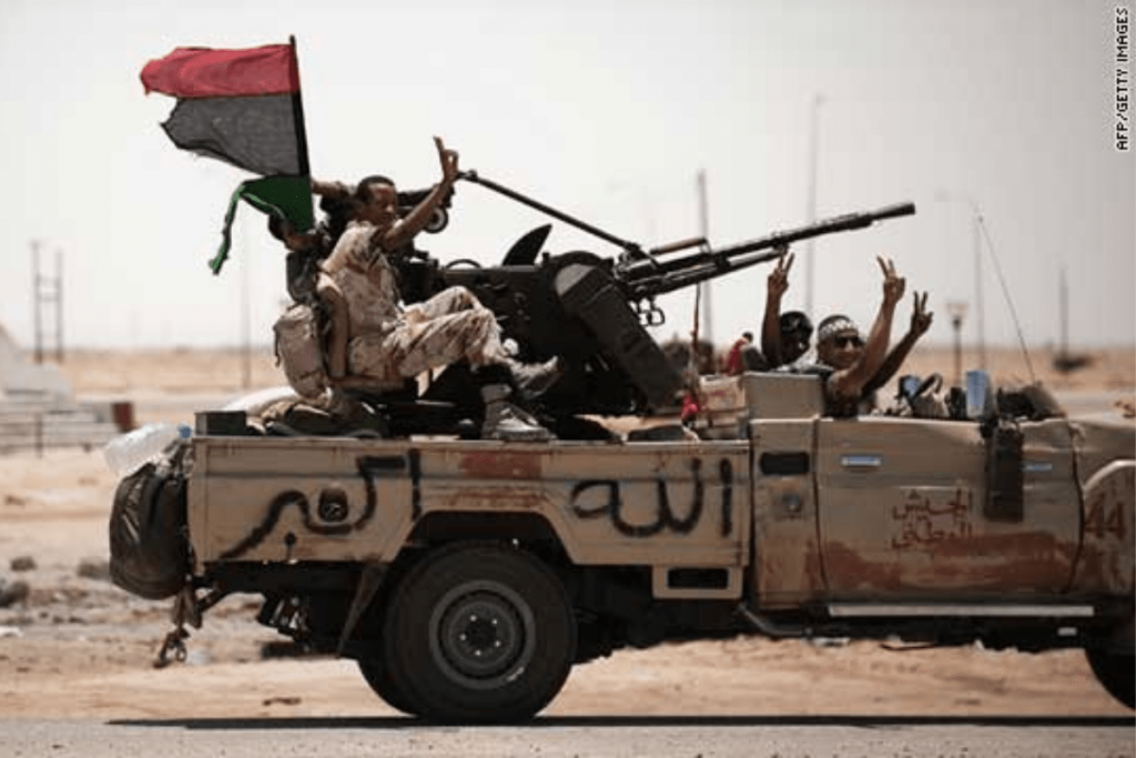 Libyan Rebel Ejected From Tank Like a Rag Doll After a Breech Explosion